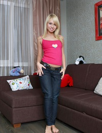 Teenage blonde undressing herself and petting her wet muff