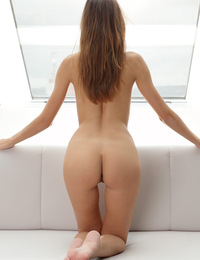 Eufrat,Seductress FHG,Eufrat eagerly slips out of her clothes and stretches her long lithe naked body on a white sofa.