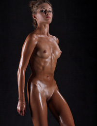 Sofia,Dripping Wet,Stunning young Sofia is dripping with oil as she poses nude in our studio.